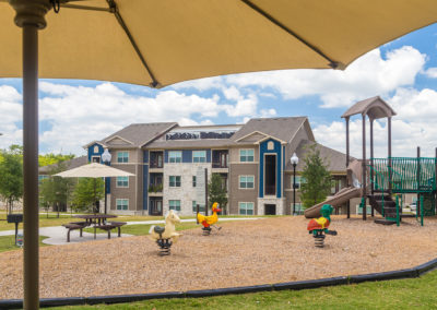Stallion Pointe apartments playground in Everman, TX