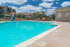 Pool area at Stallion Pointe apartments in Everman, TX