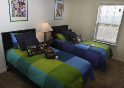 Bedroom at Stallion Pointe apartments in Everman, TX with two twin beds