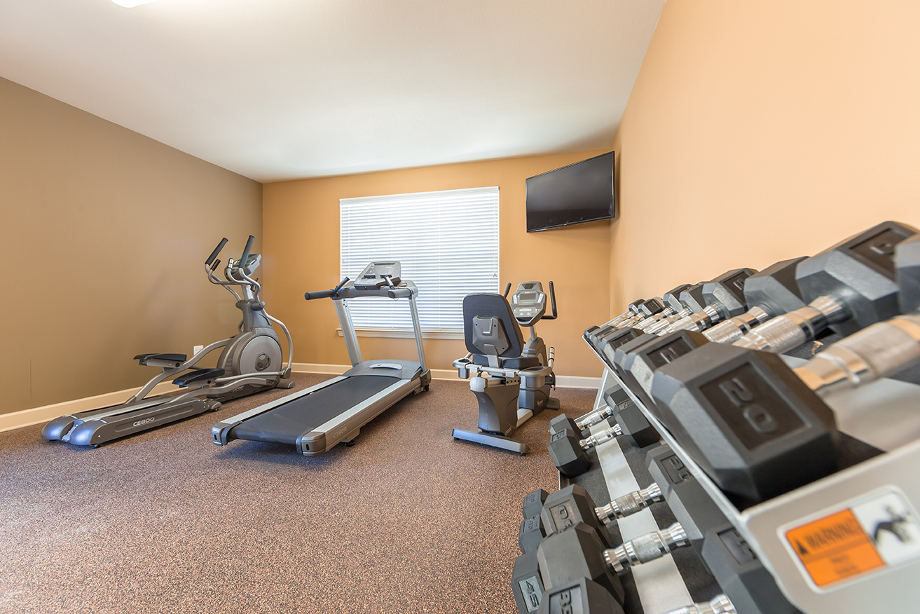 Stallion Pointe fitness center with a treadmill, elliptical, stationary bike, and free weights