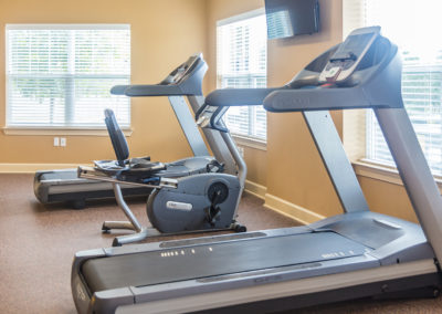 Treadmill, bike, and elliptical inside the Stallion Point fitness center