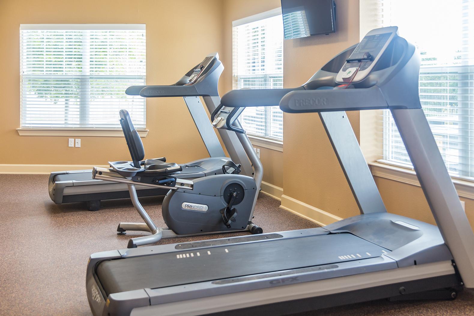 Treadmill, bike, and elliptical inside the Stallion Point fitness center